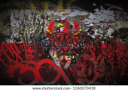 South Tyrol flag painted on dirty street wall with graffiti texture background. National political symbol street art. #1260070438