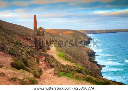 South West Coast Path as it approaches the ruins of the Wheal Coates mining engine house near St Agnes in Cornwall. #625950974