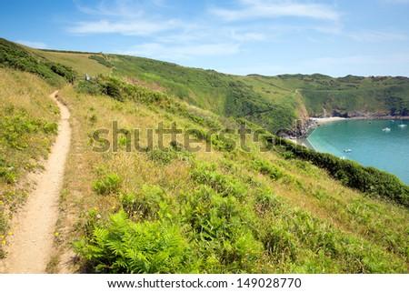 South West Coast Path to Lantic Bay Cornwall England near Fowey and Polruan on a beautiful summer day blue sky and sea