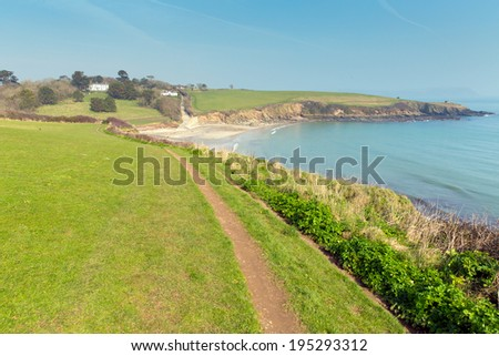 South West Coast Path view of Porthcurnick beach Cornwall England UK located north of Portscatho on the Roseland peninsula