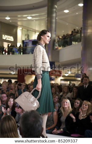 """SOUTHAMPTON, UK - SEPT. 22: A model walks the catwalk on September 22, 2011 during the filming of """"Gok's Clothes Roadshow"""" at West Quay Shopping Centre in Southampton, UK."""