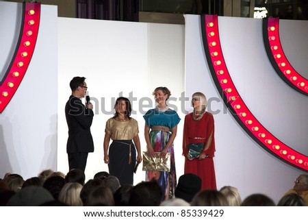 SOUTHAMPTON, UK - SEPT 22: Gok Wan introduces three local nurses who have been the subject of his makeover. West Quay shopping centre during filming of Gok's Clothes Roadshow. 22 September 2011, Southampton