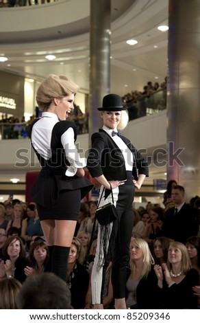 "SOUTHAMPTON, UK - SEPT. 22: Models walk the catwalk on September 22, 2011 during the filming of ""Gok's Clothes Roadshow"" at West Quay Shopping Centre in Southampton, UK."