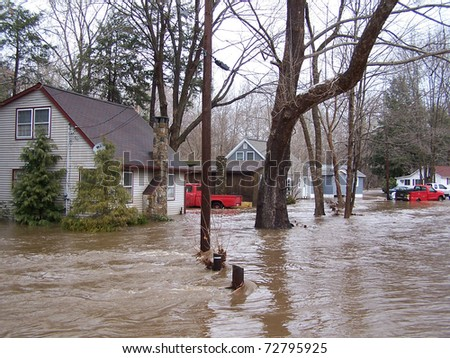 SOUTHBURY, CONNECTICUT - MARCH 7: Flooding houses along the Pomperaug River on March 7, 2011 in Southbury, CT. The neighborhood is being evacuated due to the vast rainfall and the rising river.