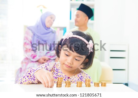Southeast Asian girl money savings concept. Asian family living lifestyle.