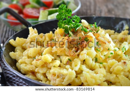 Southern German cheese noodles (spaetzle) in a serving pan