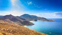 Southern Greece Mani Peninsula. Sea landscape rocky coastline and stone tower house on hill, Peloponnese.