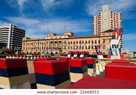 Southern Plaza in Adelaide, sculptures with state colours and part of adelaide skyline in the background including the railway station,plaza was part of south australias jubilee celebrations