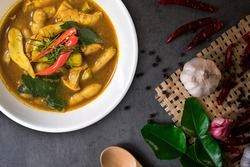 Southern Thai food.Yellow curry paste with Hausa potato in a white cup isolated on top table background with Thai food ingredients.Thai Recipes.top view.