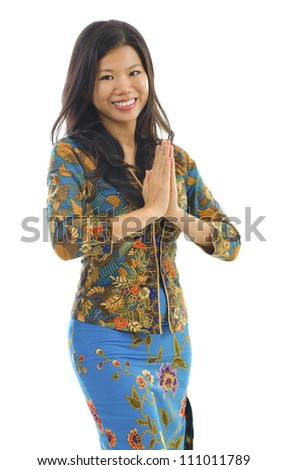 Southern Thai woman in a traditional welcoming gesture over white background