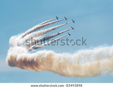 SOUTHPORT, ENGLAND - JULY 23: Hawk T Red Arrow jets from the British Air Force perform aerobatics and mid air stunts on  July 23, 2011 in Southport, England.