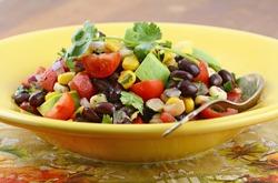 Southwestern Black bean salad with avocado, corn, tomato, red onion and cilantro in horizontal format