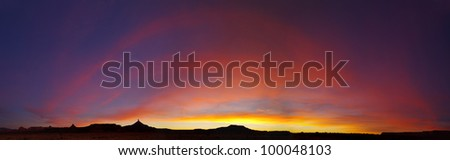 Southwestern desert sunset in the Canyonlands region of Utah with the North and South Six-Shooter towers