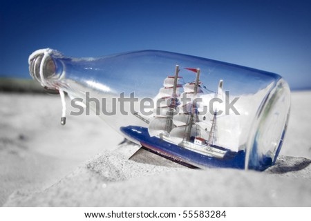 Souvenir conceptual image. Ship in a bottle. - stock photo