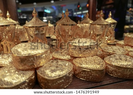 Souvenir counters in Dubai. Different statues and gifts. Stock background