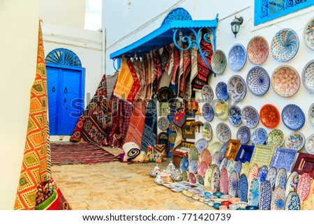 Souvenir earthenware and carpets in tunisian market, Sidi Bou Said, Tunisia.