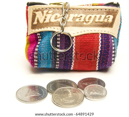 souvenir memento key chain change purse hand made woven colorful fabric made in Nicaragua with cordoba coins - stock photo