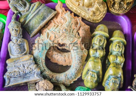 Souvenir of antique and amulet from tomb for sale at Thai-Cambodia border market. #1129933757