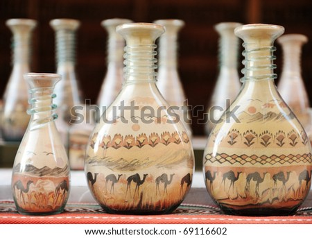 souvenirs - bottles with sand and shapes of desert and camels - stock photo