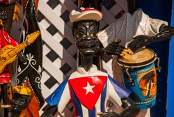 Souvenirs from Cuba. Wooden toys: the musician plays a drum or a guitar and smokes a cigar.