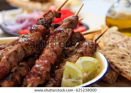 Souvlaki dish, greek food. Grilled meat skewers and pita bread in a dish. Closeup view