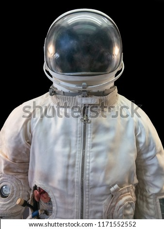 Soviet cosmonaut or astronaut or spaceman suit and helmet on black background, close up