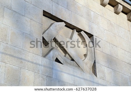 """Soviet symbols """"Hammer and Sickle"""" on the facade of the building  #627637028"""