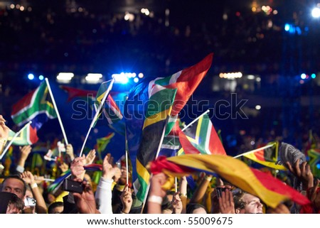 SOWETO - JUNE 10: Fans waves National Flags During the Football Anthem by K'naan at Orlando Stadium for the FIFA World Cup Kick Off Celebration Concert on June 10, 2010 in Soweto.