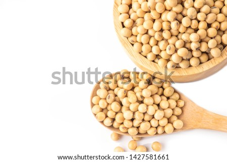 soy beans in wooden bowl and spoon isolated on white background isolated on white background #1427581661