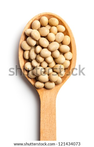 soy beans in wooden spoon on white background