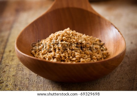 soy granules in the wooden spoon