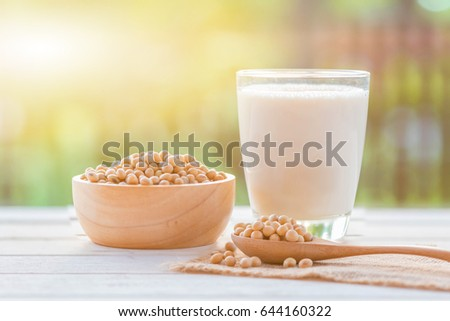 Soy milk in glass and soy bean on spoon it on white table background with lighting in the morning,healthy concept. - Shutterstock ID 644160322