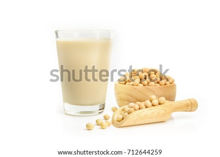 Soy milk with soybeans isolated on white background.  - Shutterstock ID 712644259