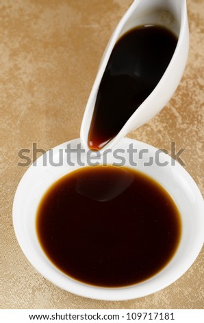 soy sauce poured to a white plate