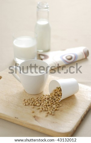 soybean and soy milk on wood background