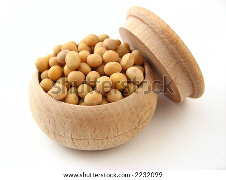 Soybean in wooden pot over white.
