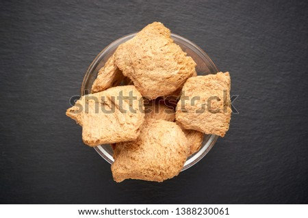 Soybean meat, meat big chunks, chunks in a white bowl on dark background. Copy space. Copy space, place for text. I love food concept.