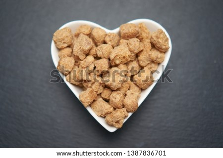 Soybean meat soy meat, meat chunks, chunks in a white bowl on dark background. Copy space. Copy space, place for text. I love food concept.