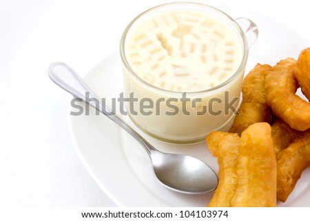 Soybean milk with fried bread stick on the white background