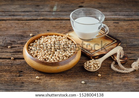 soybean with milk on wooden table background Foto d'archivio ©