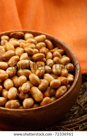 Soybeans have many health benefits as well as health risks for those with soy allergies - stock photo