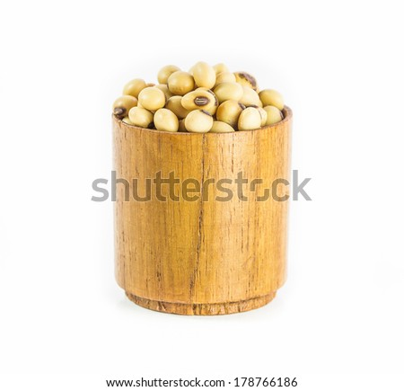 Soybeans in wood cup isolated on white background.