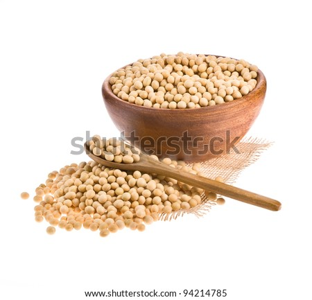 Soybeans on wooden spoon  and in a wooden bowl on a white background.
