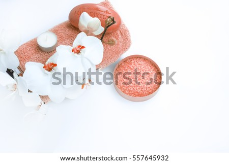 Spa accessories: soap, candle, towel, salt and orchid on white background. Spa salon, spa therapy, beauty. Spa treatment #557645932