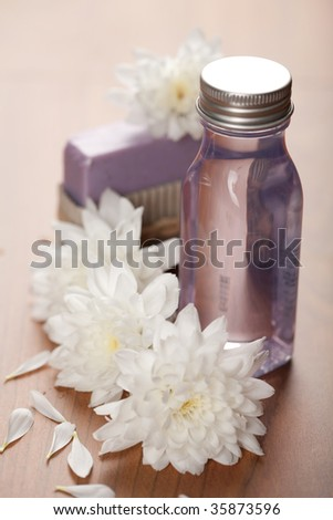 spa and body care - cosmetic bottle and flowers
