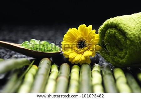 Spa and wellness-green towels, salt and salt on spoon, Daisy flowers on bamboo grove
