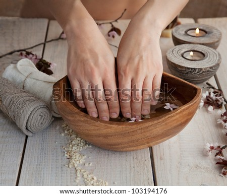 Spa and wellness manicure setting with natural soap, candles and towel. Beige dayspa nature set