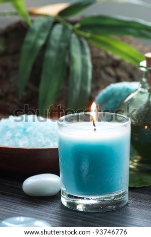 Spa and wellness  setting with bath salt, candles and towel. Blue dayspa nature set