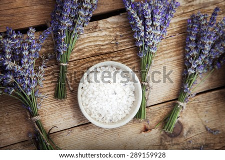 Spa and wellness setting with lavender flowers, floral water and bath salt. Dayspa nature set
