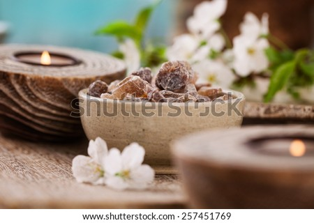 Spa and wellness setting with natural soap, candles and towel. Beige dayspa nature set with copyspace